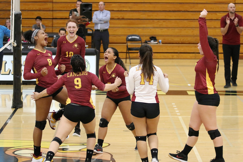The Lancers celebrate a point late in their sweep at Rio Hondo College.