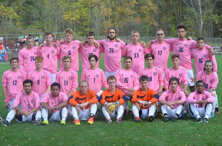Men's soccer team poses for a team photo prior to its Breast Cancer Awareness game.