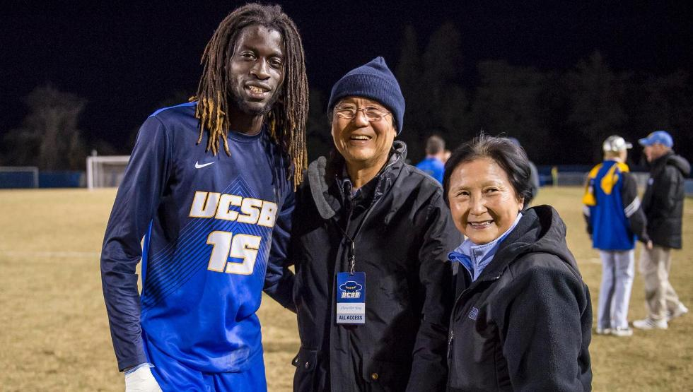 Ismaila Jome, pictured, takes a photo with UCSB Chancellor Henry Yang after scoring the game-winning golden goal to send UCSB to its first Sweet Sixteen since 2011 (photo by Tony Mastres)