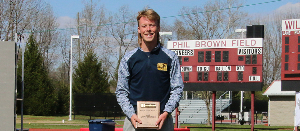 Clayton Brumfield with his HCAC Championship plaque (Photo courtesy of Rose-Hulman Sports Information)
