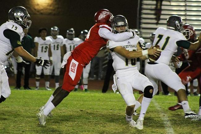 Mesa's Elijah Jeffcoat sacks the Scottsdale quarterback with authority in the T-Birds victory over Scottsdale.