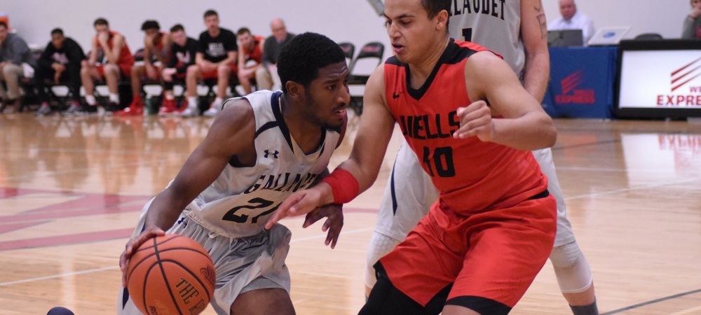GU guard Corey Smith drives up against a Wells defender in an away game.