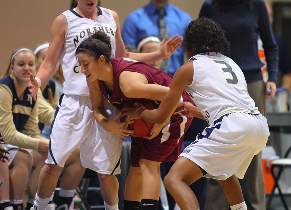 Santa Clara's Meagan Fulps is tied up by Northern Colorado defenders Wednesday night in Greeley. UNC won 65-57. (Photo by Paul Dorweiler)