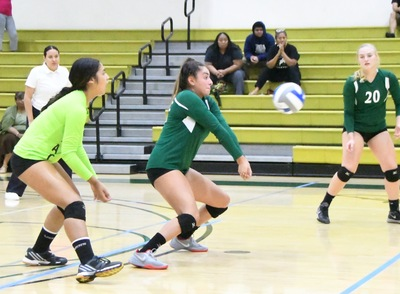 East Los Angeles College volleyball freshman outside hitter Bela Gamboa gets a key dig. (Photo by DeeDee Jackson)