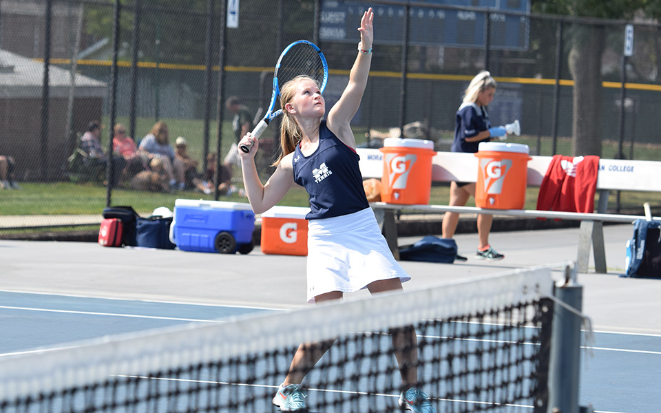 Julianne Cassady gets ready to hit a shot at the net in doubles action versus DeSales University at Hoffman Courts.