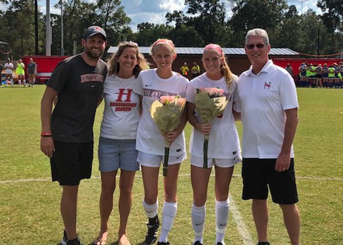 Seniors Jenna Maschino and Meredith Harrison were recognized on Saturday during Senior Day. (Photo by Vic Jerald)