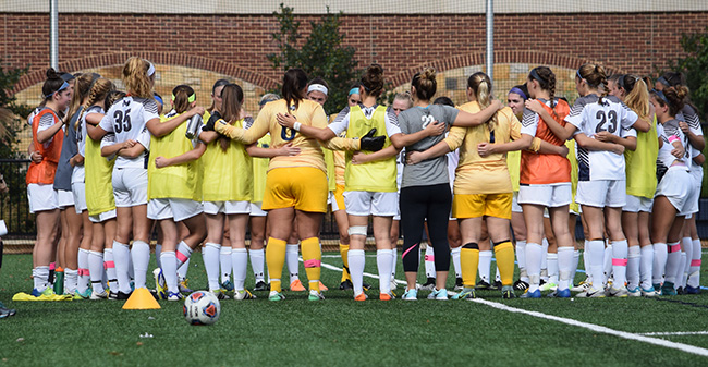 The Greyhounds prepare for the second half of a Landmark Conference match versus Goucher College.