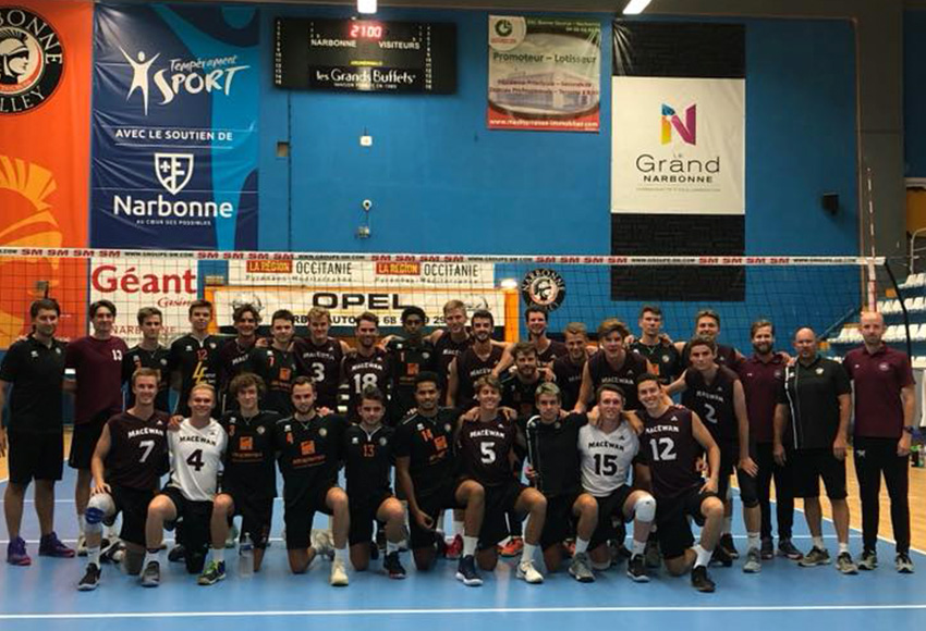 The MacEwan Griffins men's volleyball team poses in the gym of Montpellier, France pro club team Narbonne, a squad they defeated 3-1 on Aug. 27.