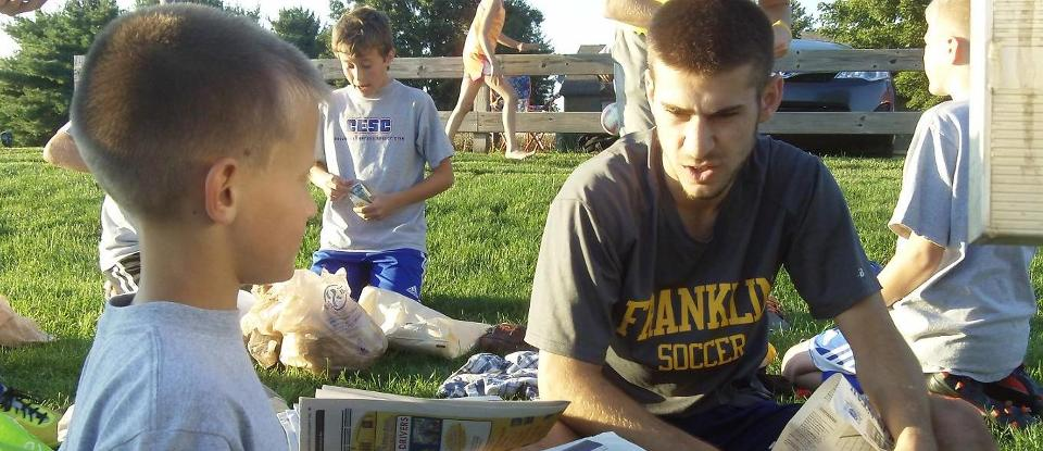 Men's Soccer Players Participate in 'Make Your Own Ball Night' Program
