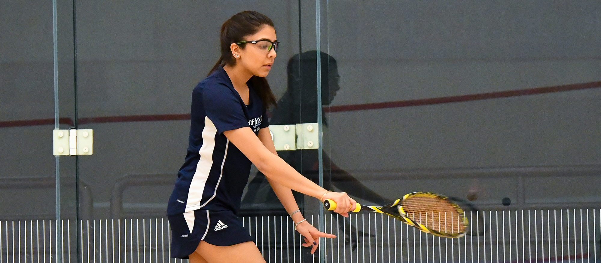 Action photo of Lyons squash player, Ragini Ghose.