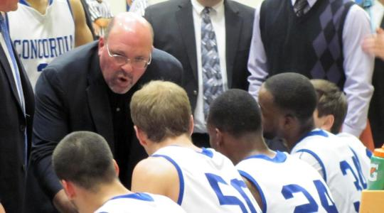 Assistant Jon Cain rallies the troops