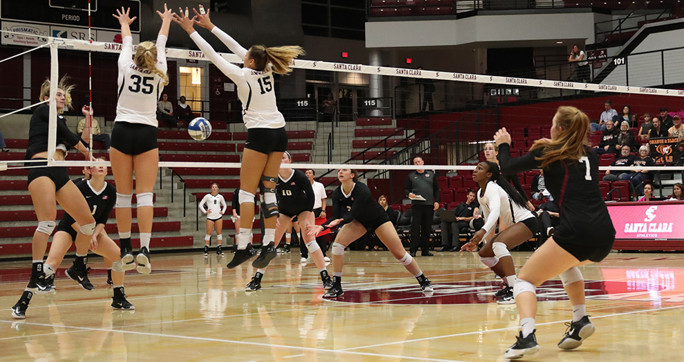 Michelle Gajdka (35) and Taylor Odom (15) turn back an attack attempt by Pacific on Thursday, Oct. 19, 2017 in Leavey Center.