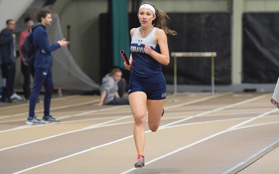 Sophomore Morgan Weaver runs in a relay race during the Moravian Indoor Invitational at Lehigh University in January 2019.