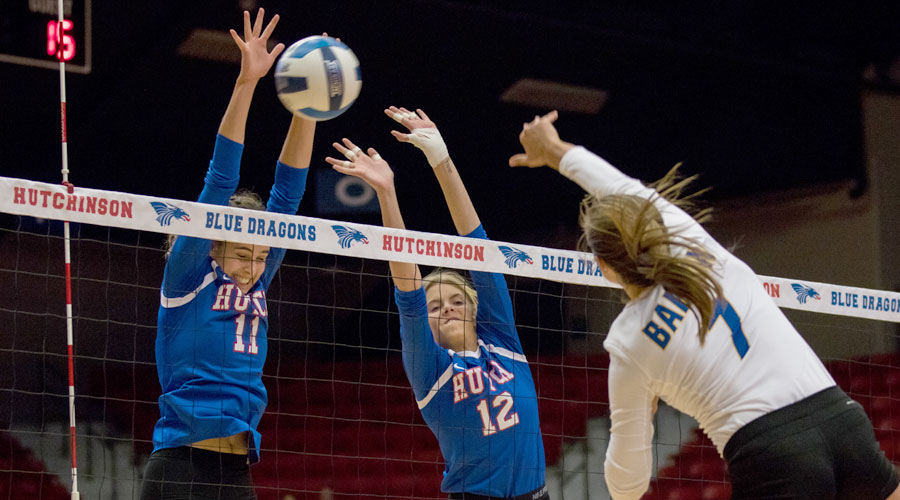 Leonie Wienkaemper (11) and Lexi Hogan (12) go up for one of Hutchinson's 10 team blocks on Wednesday as the Blue Dragons defeated Barton 3-1 at the Sports Arena. (Allie Schweizer/Blue Dragon Sports Information)