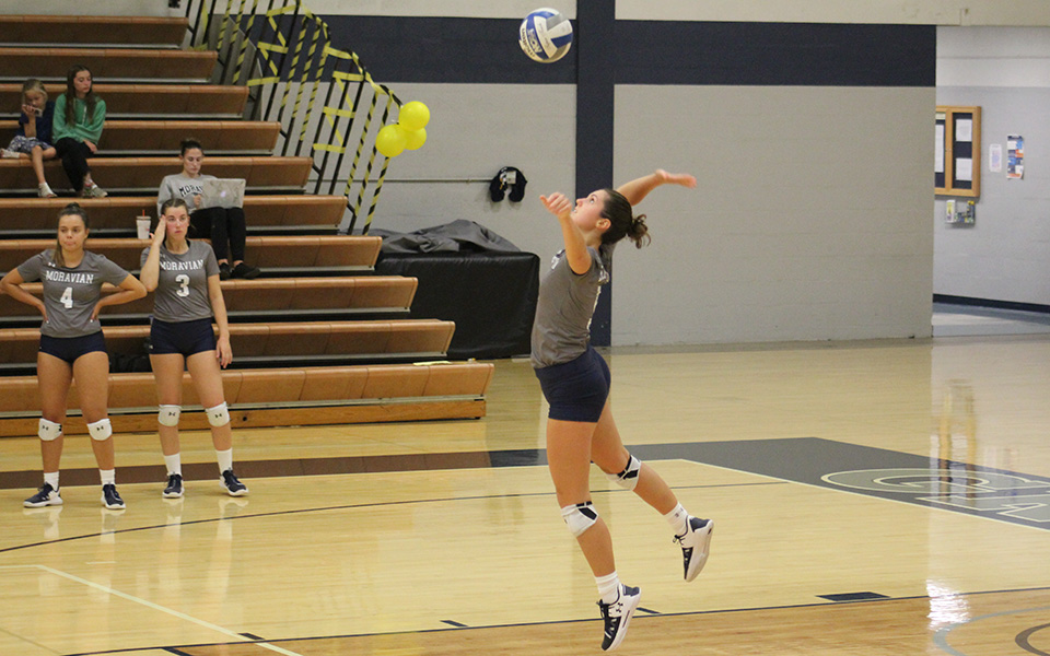 Sophomore Kirah Driesbach jumps to serve versus Cedar Crest College in Johnston Hall.