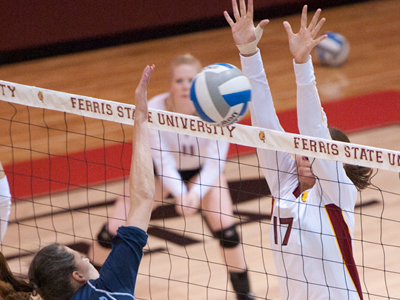 Aly Brecht attempts to block a Northwood attack in FSU's 3-1 home league win Thursday (Nov. 4) evening.  (Photo by Ed Hyde)