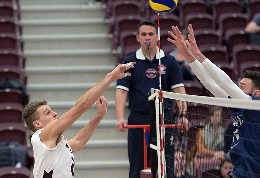 Kai Hesthammer battles at the net for a ball on Saturday night in the final home game of his distinguished four-year MacEwan career (Chris Piggott photo).