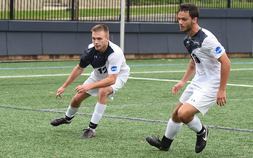 Senior defenders Brandon Percey and Michael Guarino look to get the ball in a match versus The University of Scranton on John Makuvek Field.