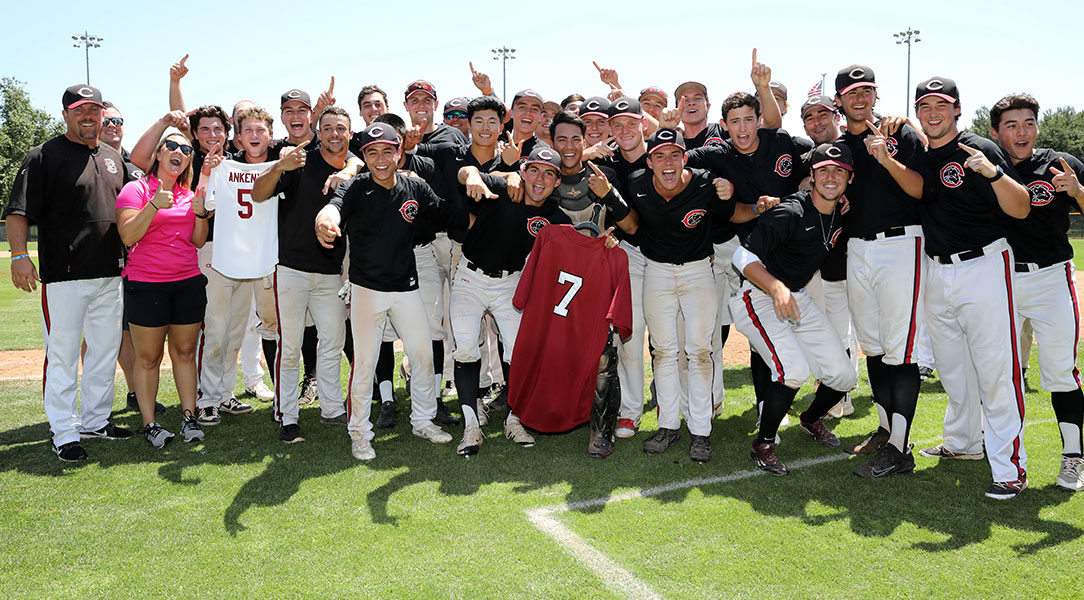 The Chapman baseball team holds up Carter Ankeny and Miguel Cebedo's jerseys.