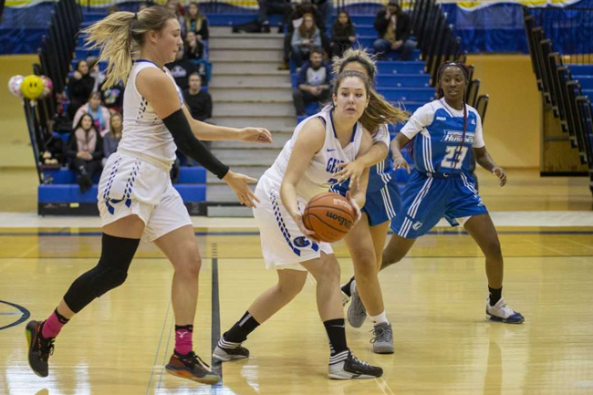 WOMEN'S BASKETBALL FALL TO HUSKIES
