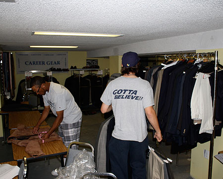 Gallaudet student-athletes sort business clothes.