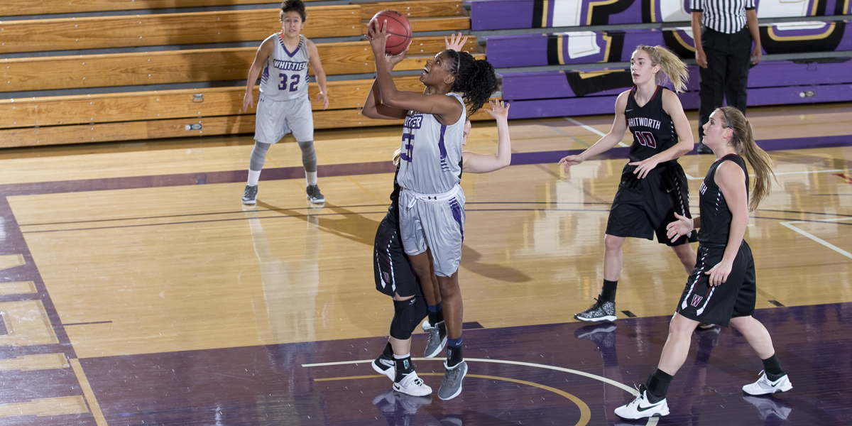 Ana Youngblood goes up for a lay-up in the Poets 67-62 victory over Whitworth University during the Purple & Gold Poet Classic.