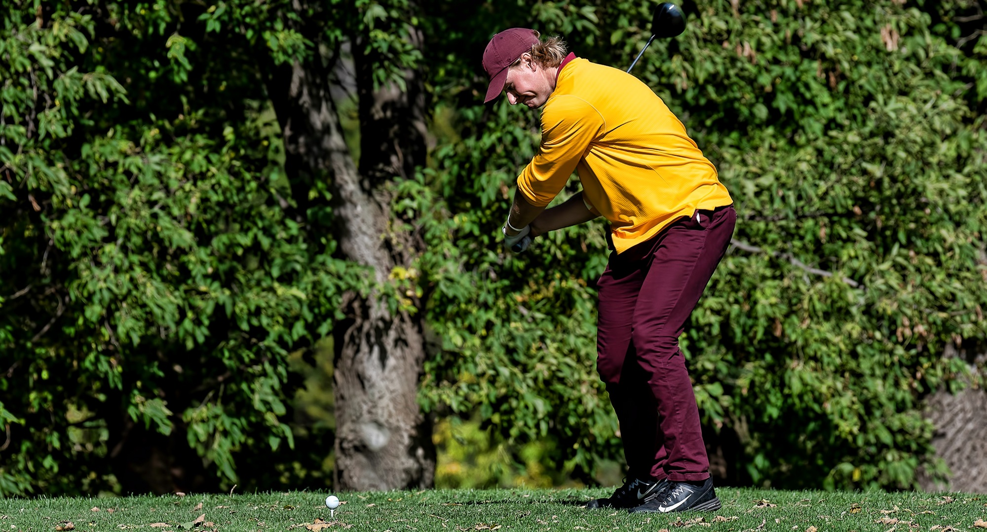 Senior Gage Stromme tees off during the first round at the MIAC Championship Meet. He is tied for the lead after 18 holes of play.