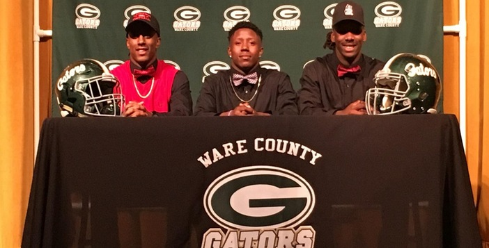 Three More Ware Football Players Sign Scholarships