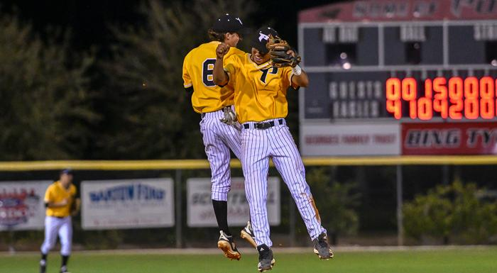 Drew Howard and Demetrio Rodriguez celebrate after the Eagles defeated Webber 11-6 at Bing Tyus Yard. (Photo by Tom Hagerty, Polk State.)