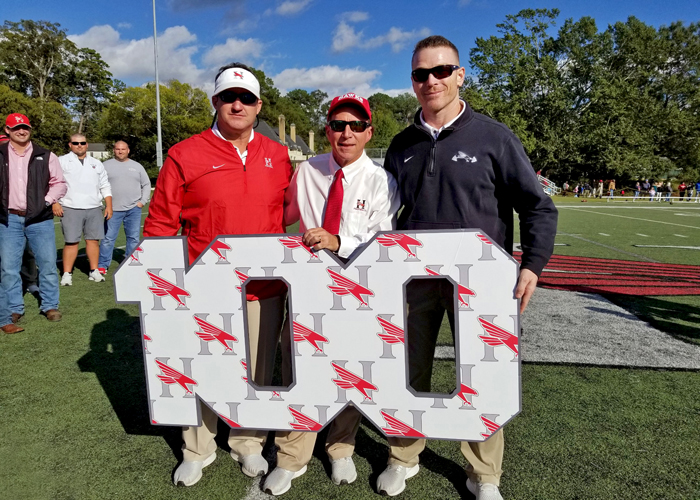 Head coach Mike Turk (center) and assistant coaches Steven Hicks (left) and Charlie Goodyear (right) were recognized after Huntingdon won its 100th game. The three have been a part of every win in program history.