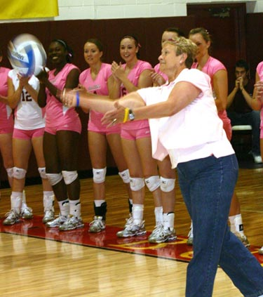 Terri Bloomquist takes the honorary serve. (Photo by Sandy Gholston)