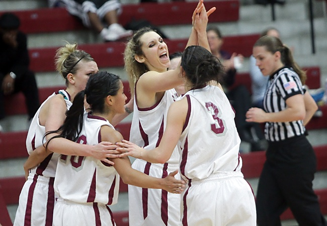 Lindsay Leo (center) and the Broncos celebrate during the team's win over Seattle on Sunday (John Medina Photo)