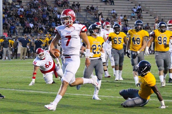 Mesa quarterback, Thomas MacVittie (#7), runs in the T-Birds first touchdown of the season in the first quarter at Phoenix College Saturday night. MacVittie accounted for two rushing and two passing touchdowns for the T-Birds. (Photo by Aaron Webster)