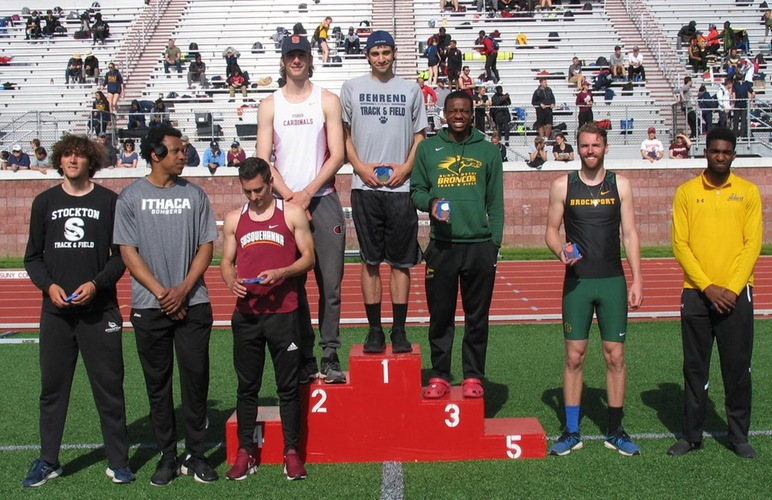 Glenn Butler standing in third place on the podium for earning bronze in the high jump.