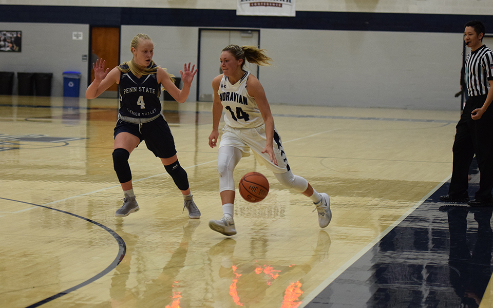 Junior Karlie Brogan dribbles towards the basket versus Penn State Lehigh Valley