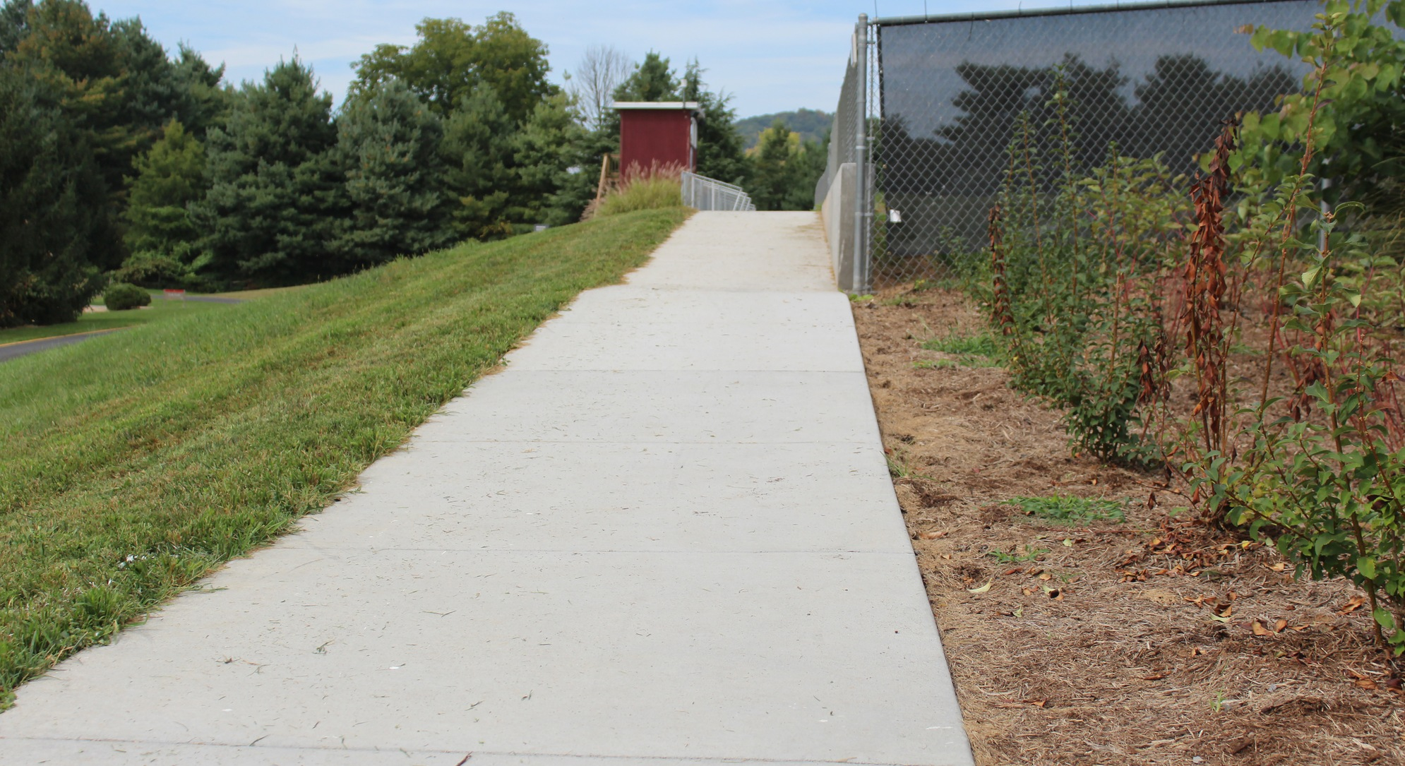 paved ramp to soccer field seating