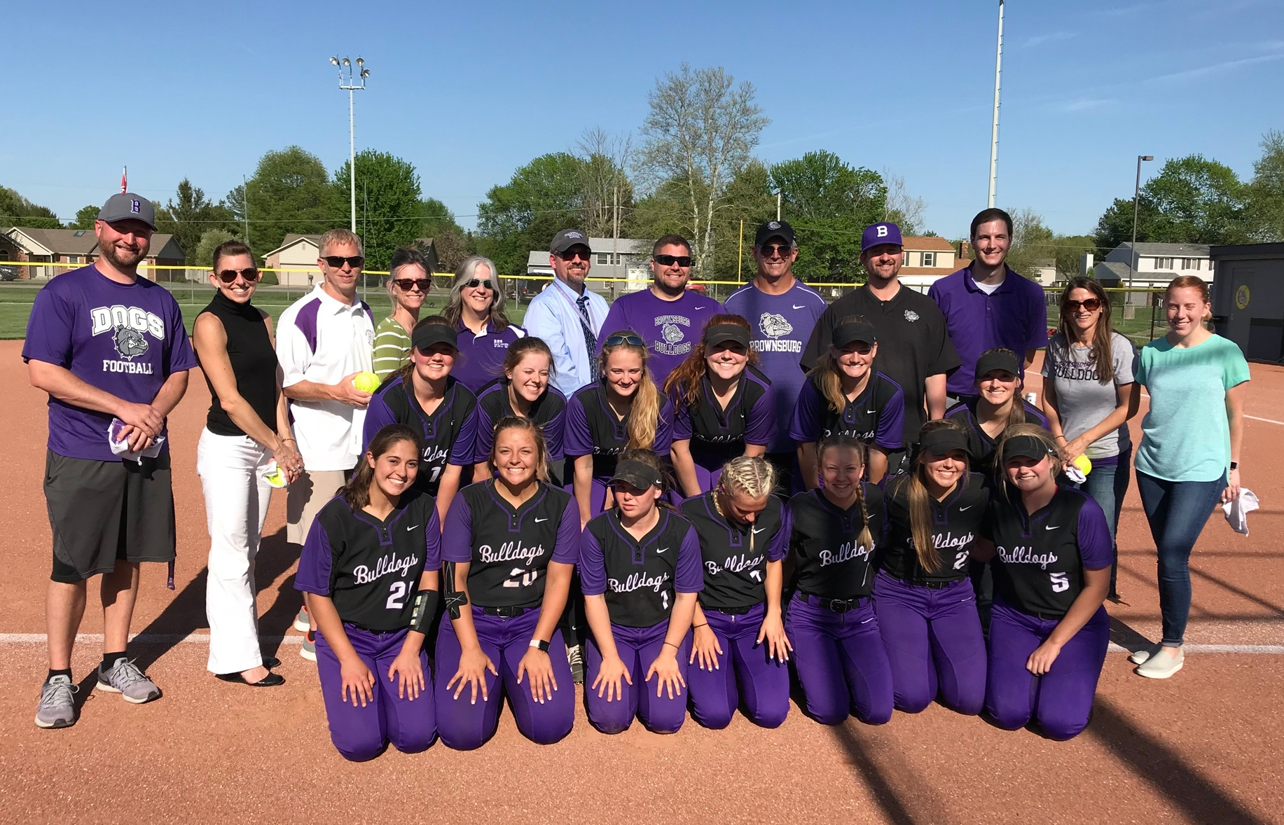 Bulldogs Honor Educators at Softball Game