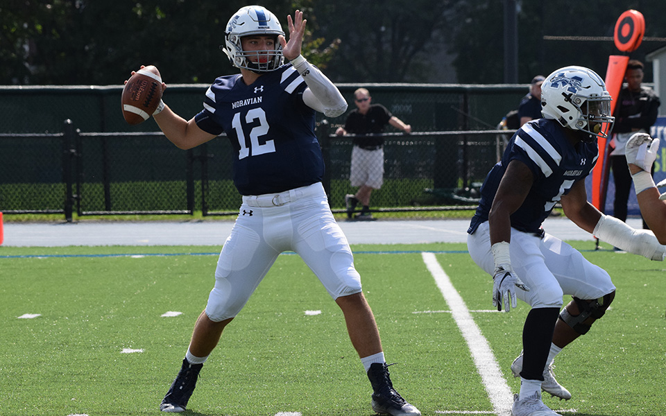 Freshman quarterback Christopher Mills attempts a pass early in the first quarter of his first collegiate start versus Gettysburg College.