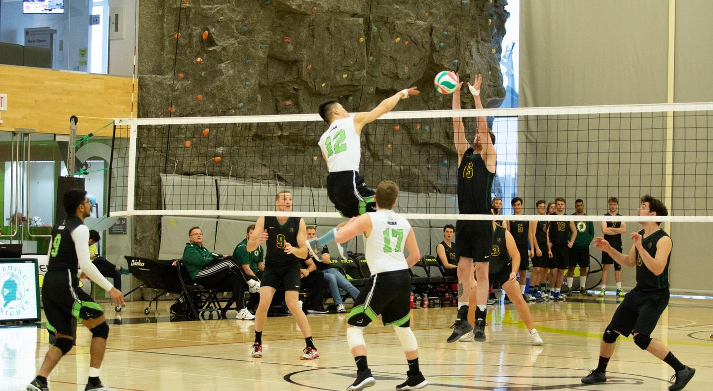 Timothy Ho of the Centennial Colts goes up for the kill as Joel Howes of the Fleming Knights tries to thwart his attempt during game action at the Athletic and Wellness Centre between the two teams. (Nicole Ventura/Colts Media)