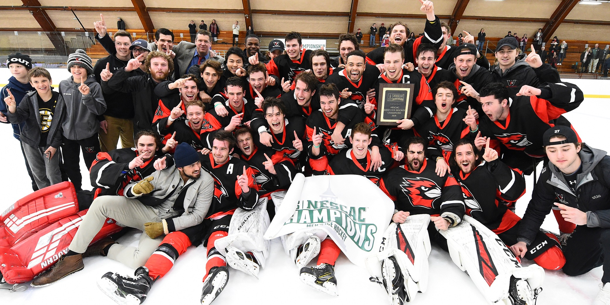 Wesleyan captured the school's first-ever NESCAC Men's Hockey Championship with a 7-2 victory over No. 8 Trinity (photo credit: Steve McLaughlin)