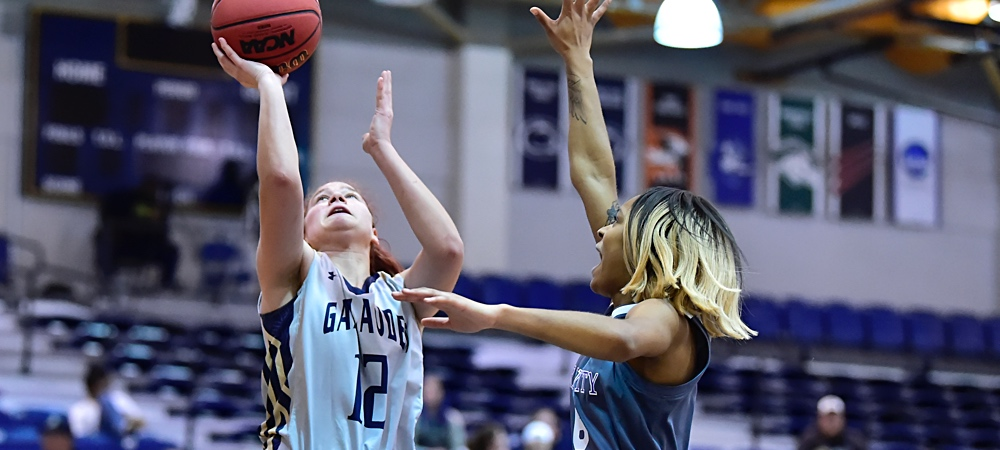 Gallaudet women's basketball forward Cassidy Perry goes up for a layup on the right side of the goal
