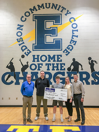 L to R: Rick Hanes, VP of Business and Community Partnerships, Nate Cole, Athletic Director, Dylan Sever, Melanie Sever, and Jim Sever.