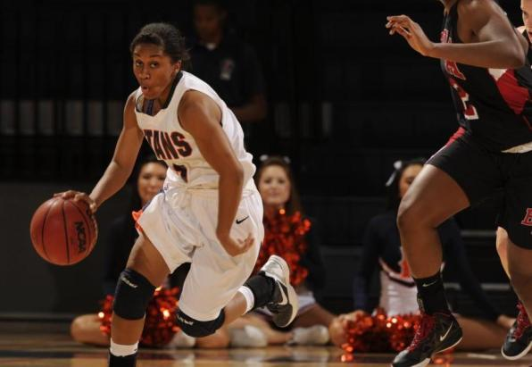 Chante Miles dribbles the ball