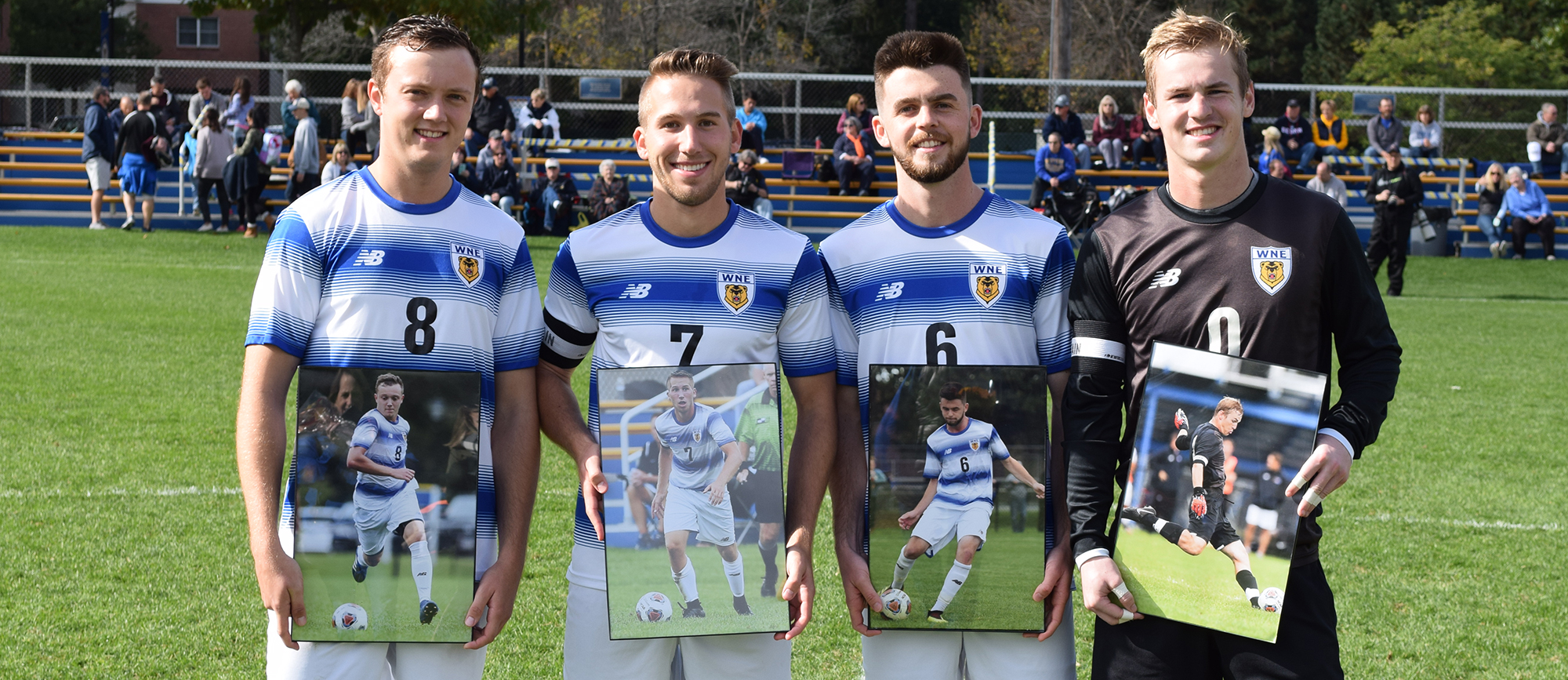 Western New England honored seniors (from left) Josh Loomis, Nick Liccardi, Brendan Siegel & Sam Brewer before the Golden Bears defeated UNE 5-0 on Saturday. (Photo by Rachael Margossian)