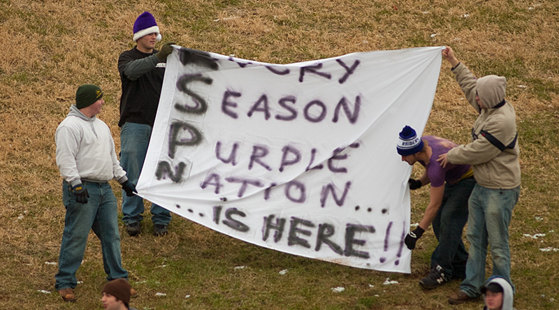 Fans holding a banner that says Every Season Purple Nation is here.