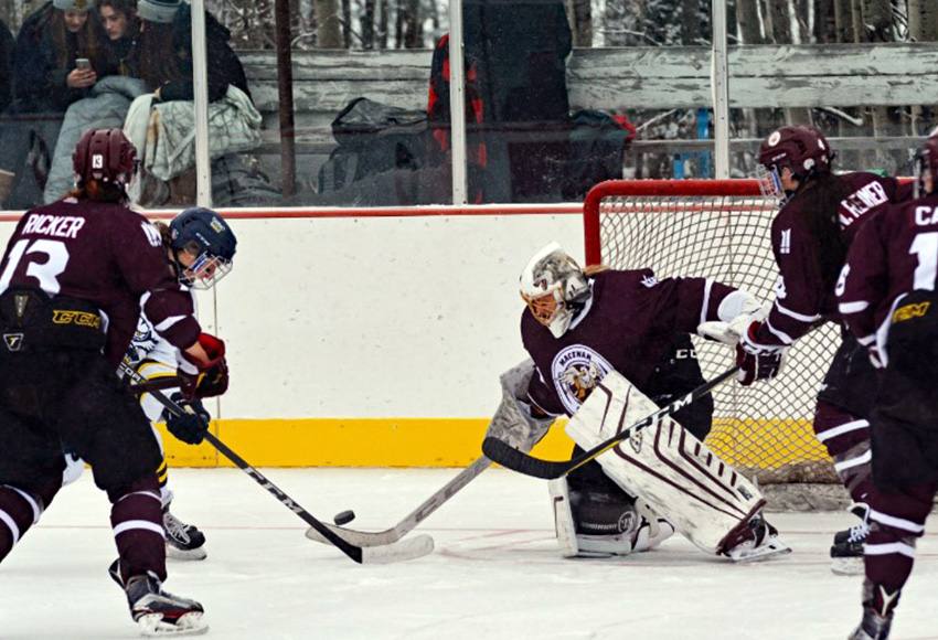 Sandy Heim makes one of her 27 saves in Saturday's Falun Frozen Female Challenge. MacEwan lost 1-0 in double overtime (Byron Weaver, NAIT Athletics).