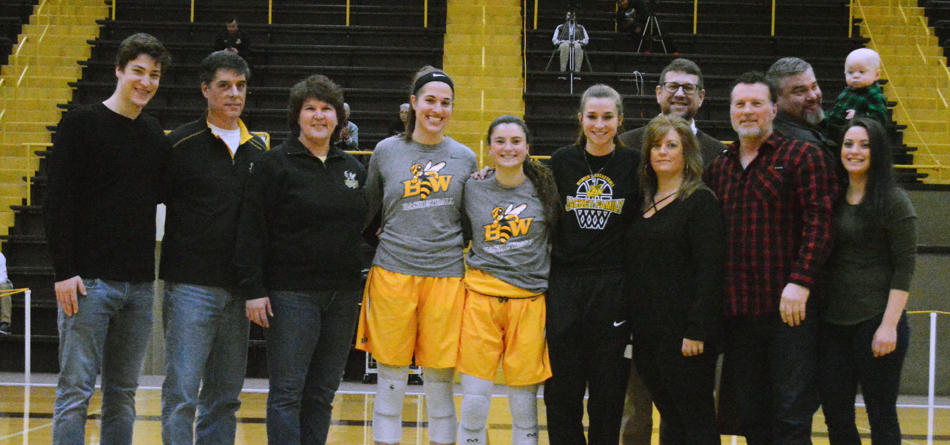 Seniors Rachel Womeldorf, MacKenzi Matthews and Hannah Fecht with their family and friends on Seniors' Day (Photo courtesy of Hailey Owens)
