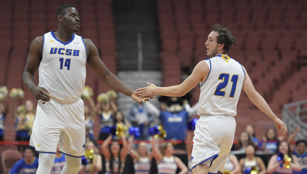 Ami Lakoju (left) and Max Heidegger (right) were instrumental in UCSB's won over Cal Poly in the first round of the Big West Tournament on Thursday night. The Gauchos will play UC Irvine in a Big West Tournament semifinal game Friday night. Tip-off is scheduled for 9:00 p.m. at Honda Center in Anaheim. (Photo by Matt Brown)
