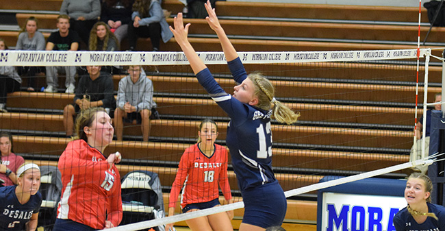 Madi Anslow '21 goes up for a block in a match against DeSales University.