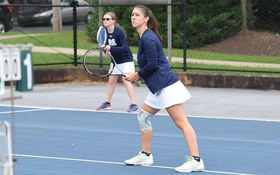 Sophomores Nicole Peluso and Destiny George await a serve in doubles action versus Cedar Crest College at Hoffman Courts.